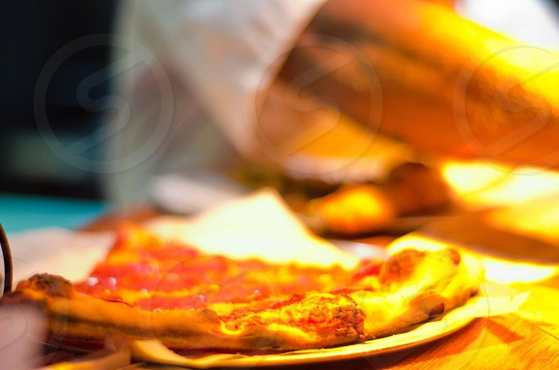 pizza slice on plate photo