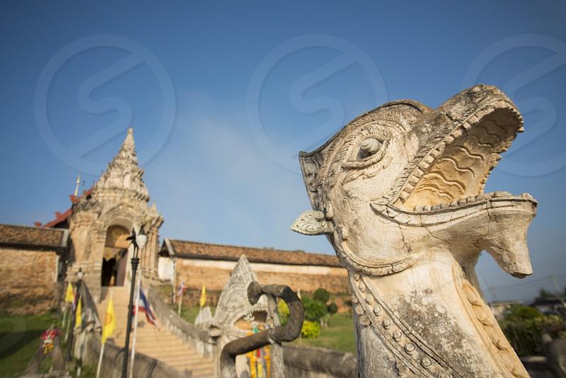 The Wat Prathat Lampang Luang near of the city of Lampang in North Thailand. photo