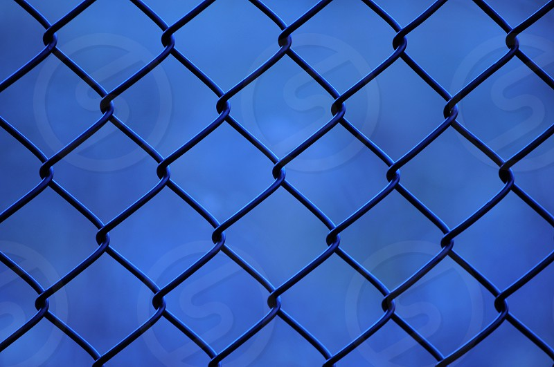 chain link fence under blue sky during daytime photo