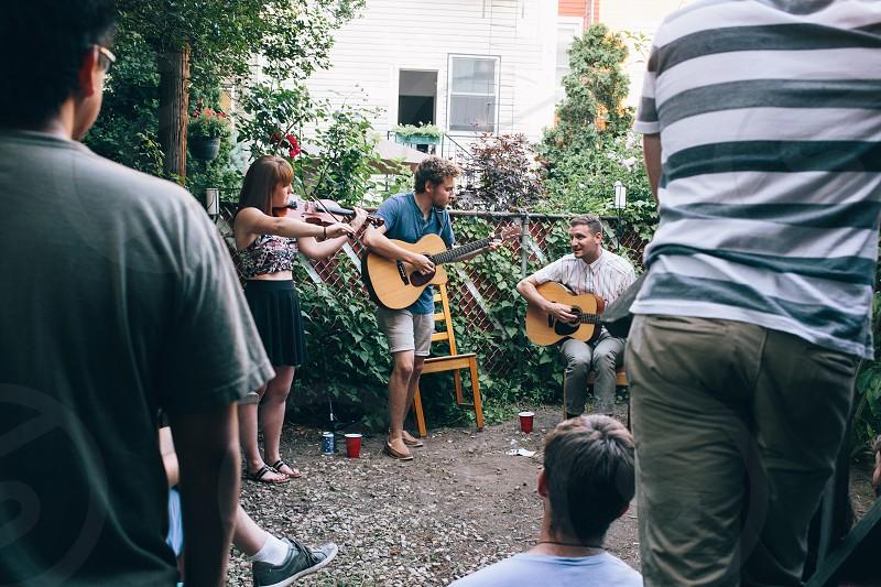 people watching people playing guitars during daytime photo