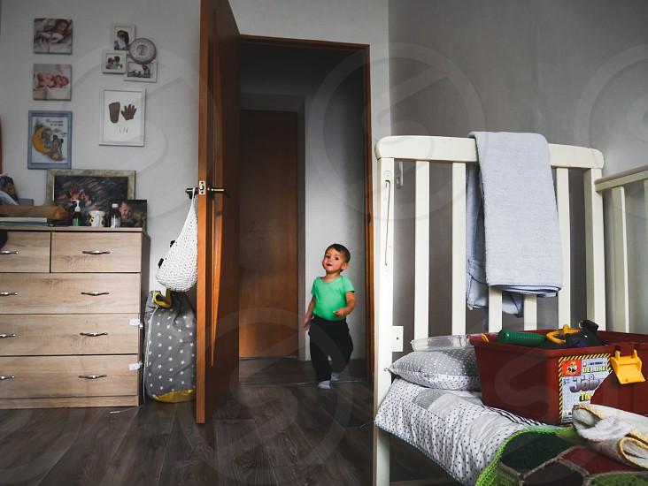 the little boy runs into his children's room photo