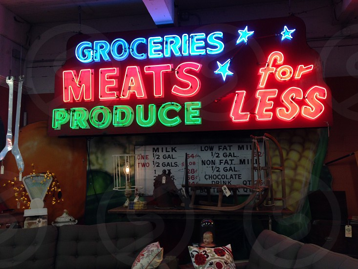 Neon sign groceries meat produce glow bright red blue green photo