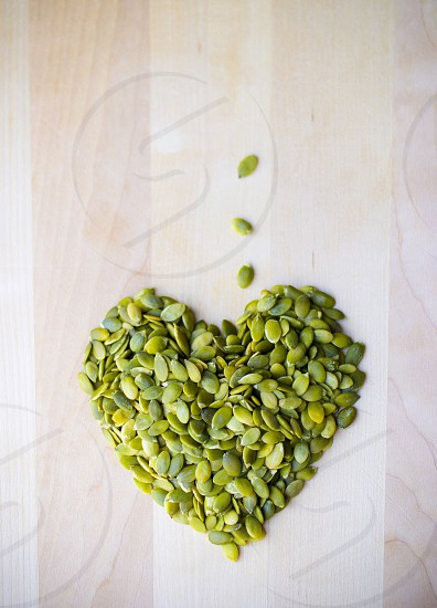 Pumpkin seeds good for heart health green wood board crunchy photo