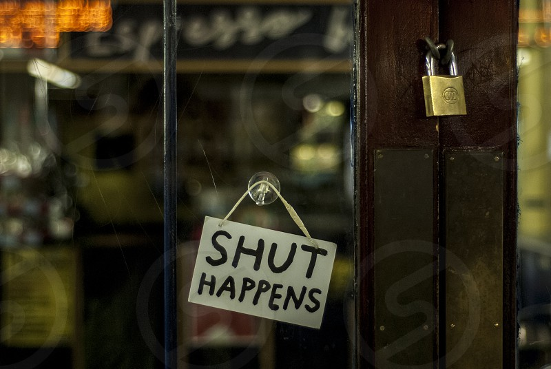 Shut Happens locked door to a coffee shop photo