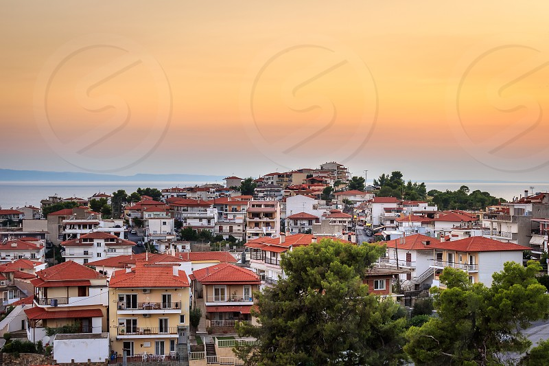Golden hour view of amazing Neos Marmaras cityscape in Greece from a nearby vantage point photo