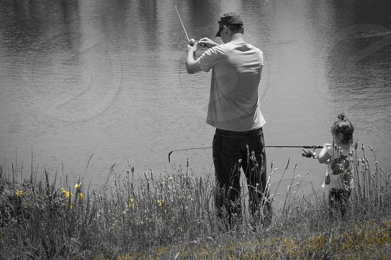 Father and daughter moments memories fishing pond over grown field photo