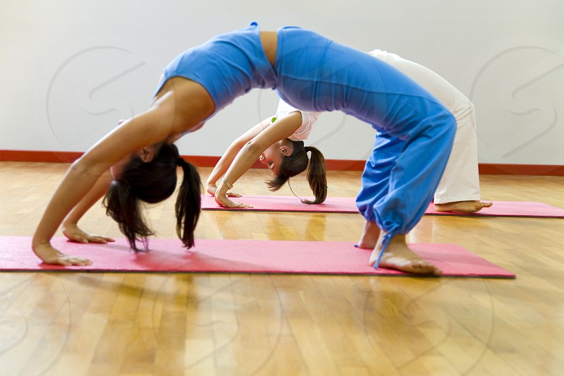 active; exercising; stretching; athlete; body; woman; healthy lifestyle; wealth; relaxation; muscle; muscular; meditating; zen-like; yoga; sports clothing; flexible; fitness; vitality; action; work out; wealthy; well-off; working out; relax; workout; relaxed; agile; relaxing; agility; stretch; exercise; muscled; gym; physical fitness; vigorous; muscular body; muscular build; meditate; meditation; lively; flexibility; girls; female; contortionist; lose weight; aerobics; sport; health club photo