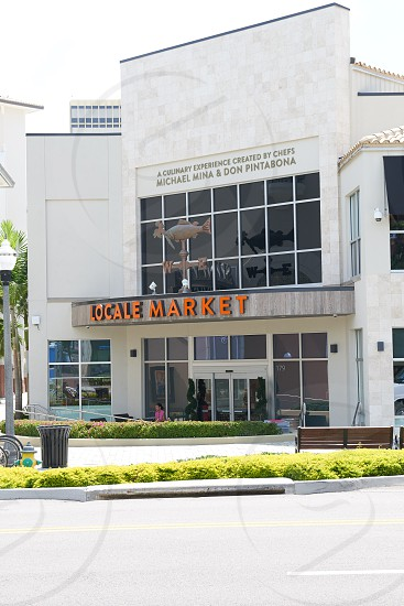 locale market building under gray cloudy sky during daytime photo