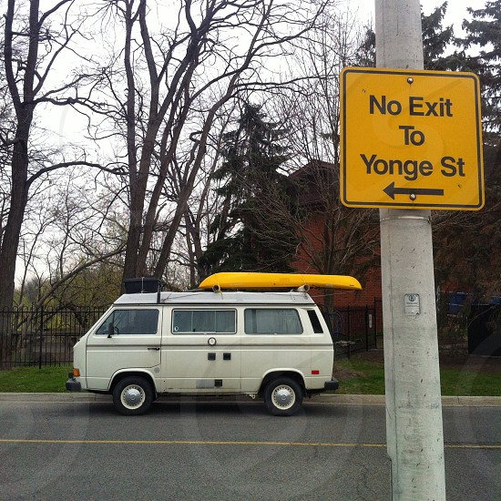 #Yellow 'Submarine' #water vessel on top of WW van (and yellow road #sign) in the Greater #Toronto Area #Canada. photo