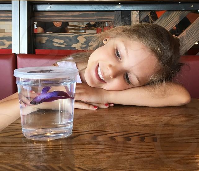 Girl pet fish smiles  photo