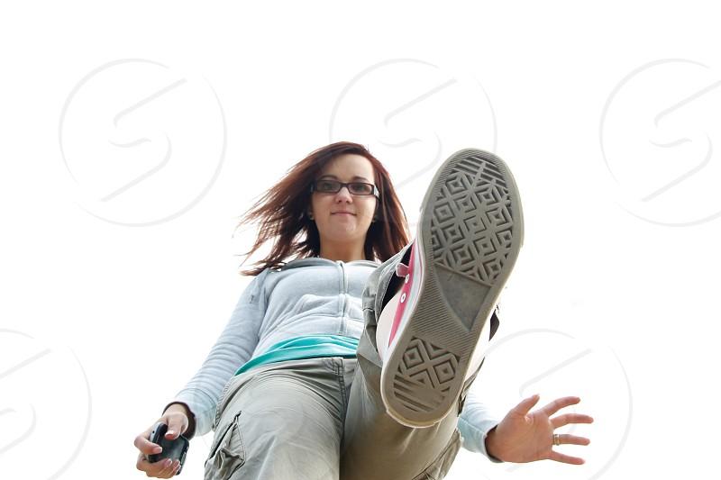 woman wearing eyeglasses stepping on road photo