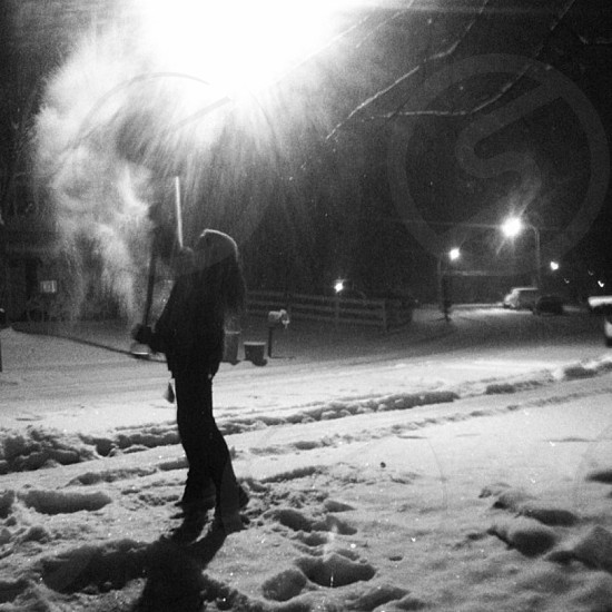 grayscale photo of woman holding shovel photo