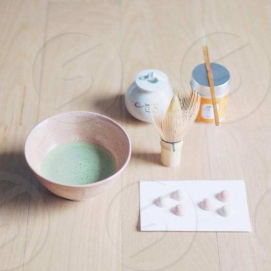 white ceramic bowl beside white rectangular paper on table photo