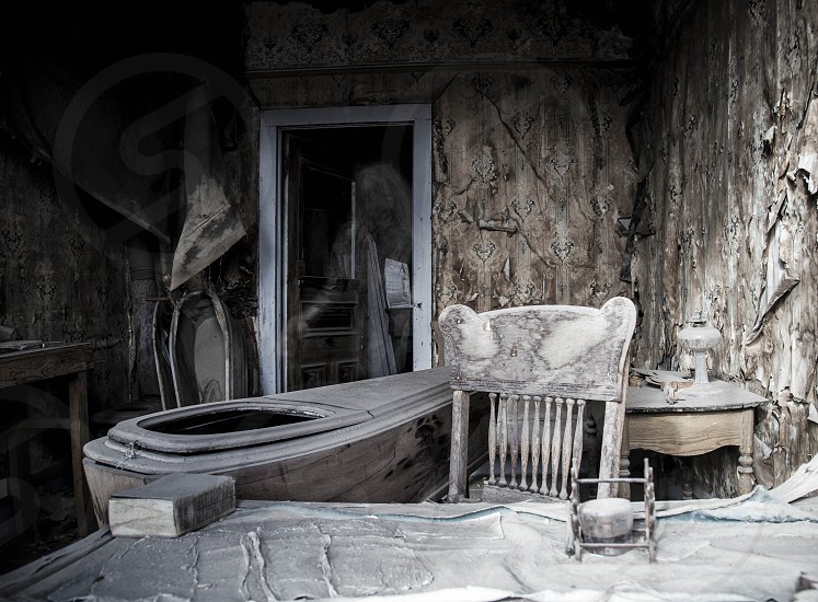 Ghostly apparition entering abandoned decaying room in ghost town. photo
