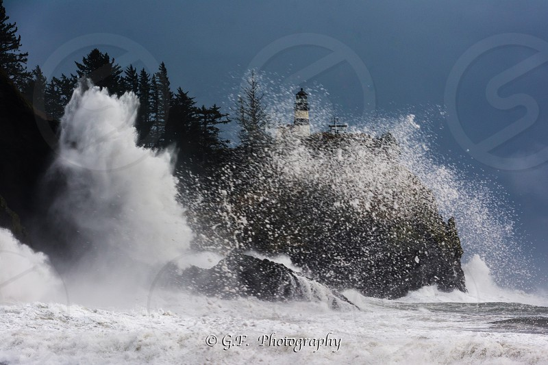 captures of break waves by cape disappointment  Washington infant of the lighthouse photo