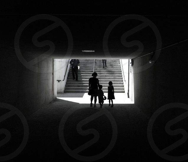 woman standing under tunnel with children photo