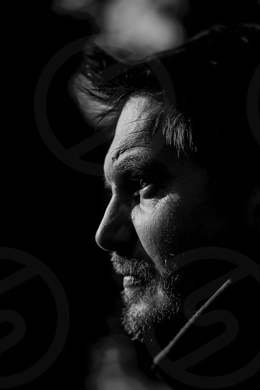 Man portrait beard face profile art black and white look wise smart visionary futuristic middle age shadow low key shape contours lines. photo