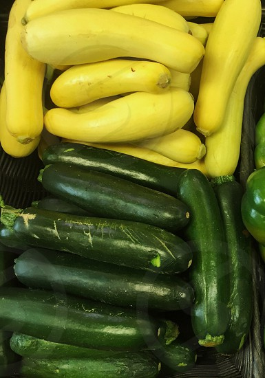 yellow bottle gourds and green cucumbers photo