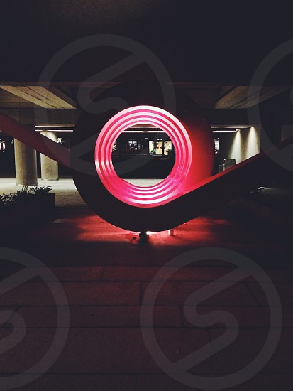 round decorative sculpture with red lights photo