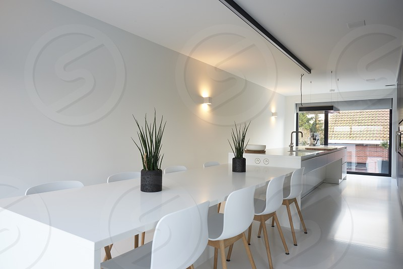 Photo by Sash Alexander, - Ultra modern designer kitchen with all modern  appliances in a bright white interior space