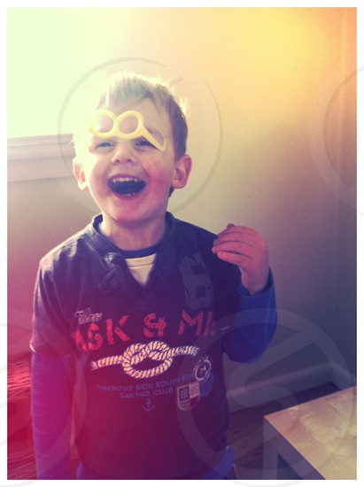 Child boy laughter silly glasses fun joke laugh smile happy photo