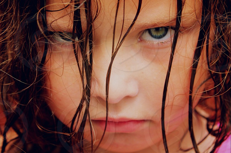 Girl grumpy powerful eyes kid child unhappy abuse intense photo