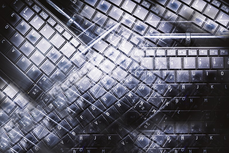 Abstract composition made of computer keyboard blended keys and textures.  photo