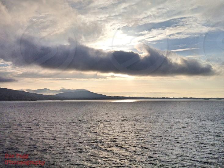 ocean over nimbo stratus clouds photo