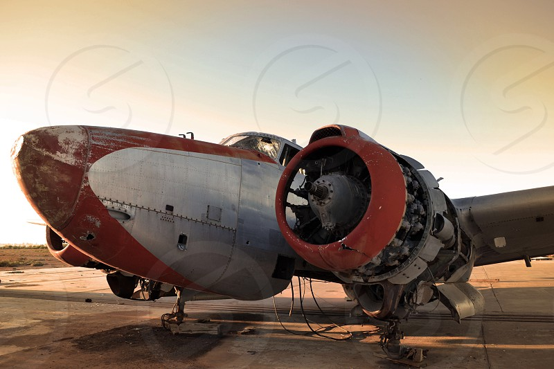 Old abandoned rusting plane photo