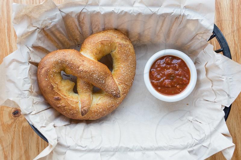 pretzel with brown sauce photo