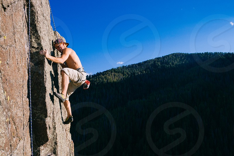 A climber ascends a granite wall in Bozeman Montana photo