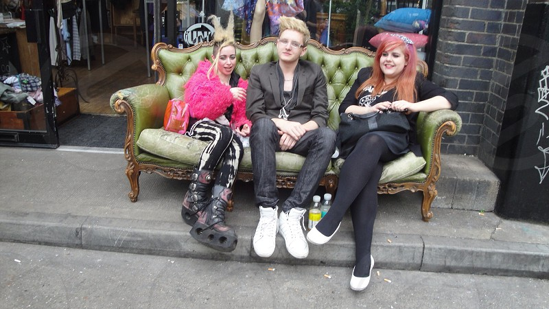 three person sitting on couch photo