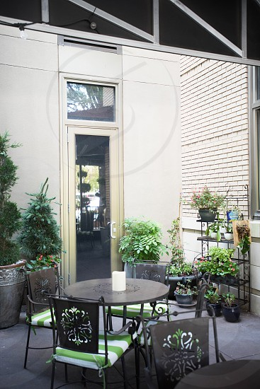 exterior restaurant tables chairs patio greenery plants photo