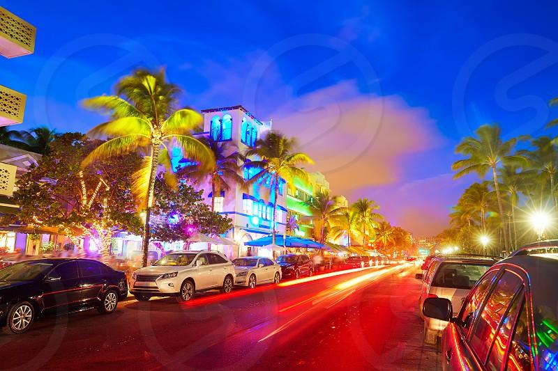 Miami Beach South Beach sunset in Ocean Drive Florida Art Deco and car lights photo