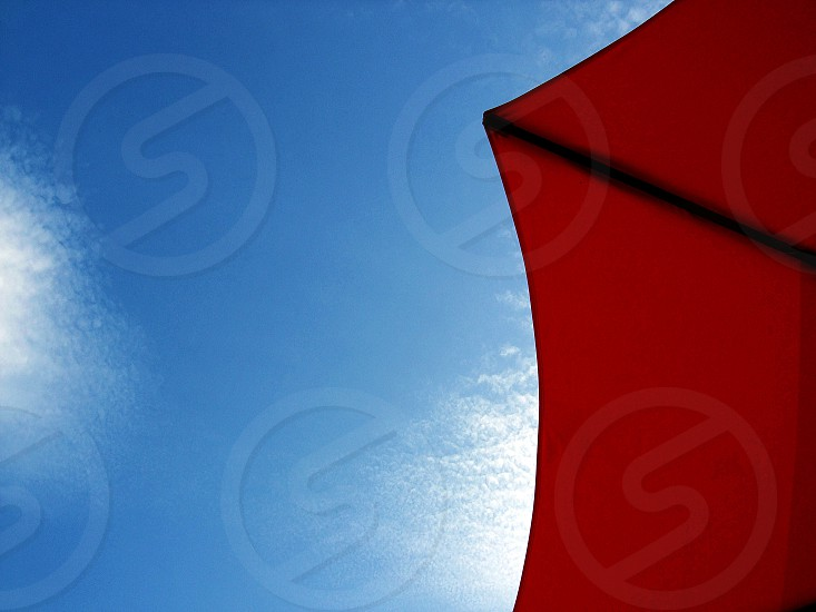 red umbrella dn blue sky photo