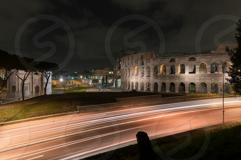 Night landscape of one of the most famous places in the world surrounded by the lights of the Italian capital. photo