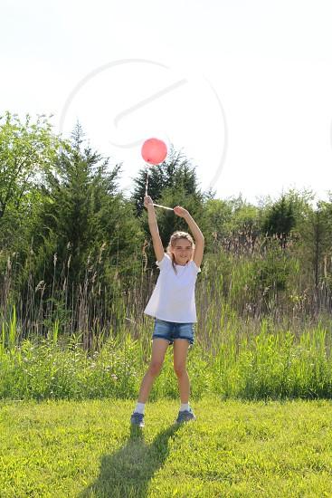 girl playing balloon summer fun photo
