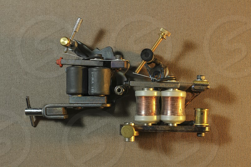 tattoo machine with accessories and needles tubes made in color background photo