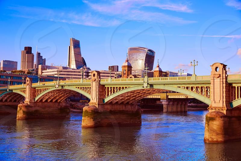 London Southwark bridge in Thames river UK photo