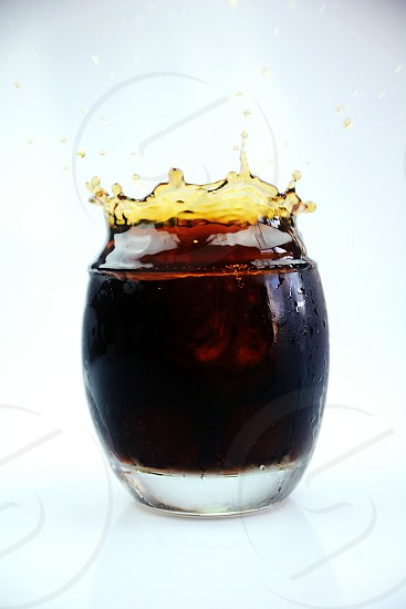 coke black drink splash glass white taste photo