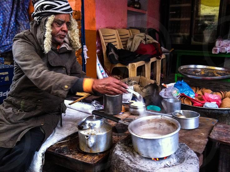 Local chai tea vendor in Varanasi India photo