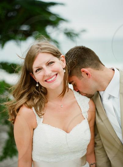 wedding couple bride groom beach wedding destination wedding wedding gown pretty white tan young photo