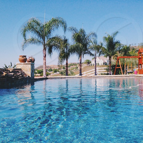 view of a swimming pool with playground on the side photo