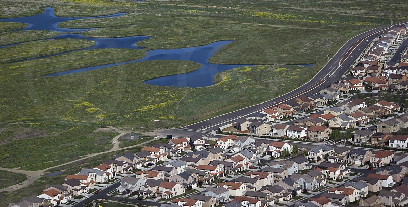 Proximity of a Stockton CA housing subdivision next to a wetland in the California Delta the west's largest estuary that provides water for 23 million Californians. photo
