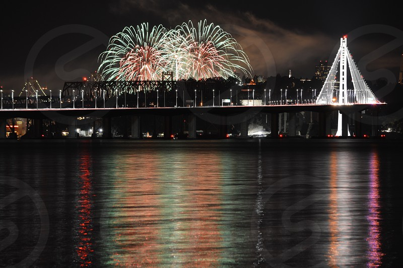 City and firework reflection photo