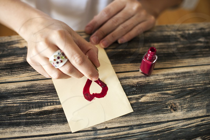 Drawing heart with nail enamel photo