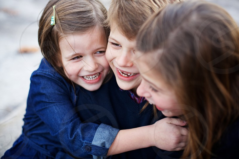 Candid image of kids laughing and hugging. Good times! photo