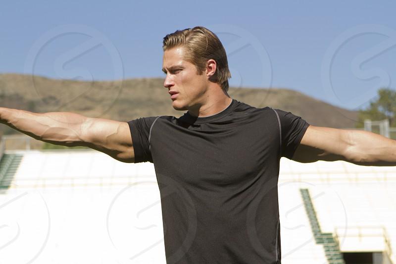 man in black t shirt extending hands photo