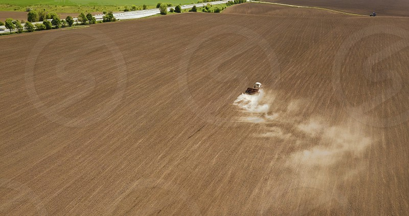 Aerial view of harvester tractor in a field creating an abstract background texture. Photo by drone photo