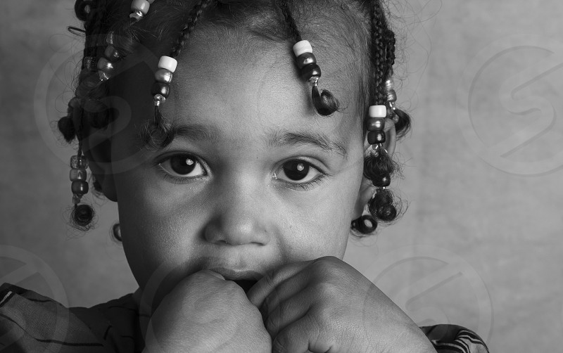 Is a black and white portrait with a really expressive small african girl ! photo